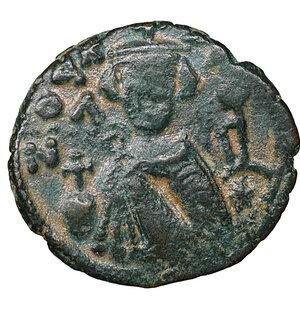 obverse: ARAB-BYZANTINE. 660s-680s. AE fals. Hims (Emesa). 4,03 gr. – 20,8 mm. O:\ Facing imperial bust, holding globus cruciger; KAΛωN to left, bi-hims to right. R:\ arge m; star between two scroll ornaments above, ЄMI-CHC flanking, tayyib below. Album 3524; SICA 548; Walker 57. Rare. XF+