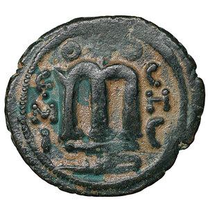 reverse: ARAB-BYZANTINE. 660s-680s. AE fals. Hims (Emesa). 4,03 gr. – 20,8 mm. O:\ Facing imperial bust, holding globus cruciger; KAΛωN to left, bi-hims to right. R:\ arge m; star between two scroll ornaments above, ЄMI-CHC flanking, tayyib below. Album 3524; SICA 548; Walker 57. Rare. XF+