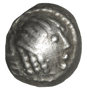 obverse: ARABIA. Southern. Himyar.  Amdān Bayān Yahaqbiḍ. 100-120 AD. AR Fraction. 8.5 mm -0.40 g, 8h. Scyphate type with name  Amdān Bayān. Raydan mint. O:\ Head right within dotted circle interrupted by monogram to left. R:\ Small head right; 'scepter' to right. CAF 3.4iii; Huth 444; SNG ANS –. VF+ toned. Rare.