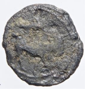 reverse: Mondo Greco.Campania. Neapolis. (Circa 250-225 A.C). AE 17 mm. D/ Testa laureata di Apollo a destra. R/ Toro androcefalo a destra sopra un delfino.Peso 2,65 gr.Diametro 17,50 mm. qBBSimbolo molto raro