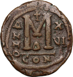 reverse: Justinian I (527-565).. AE Follis, Constantinople mint