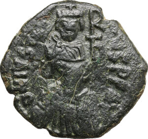 obverse: Heraclius (610-641).. AE Follis of Justin I, Constantinople mint, countermarked by Heraclius (Sicily mint)