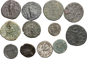 reverse: Roman Republic and Empire.. Multiple lot of twelve (12) unclassified AE coins, including an As of Trajan and a Sestertius of Commodus