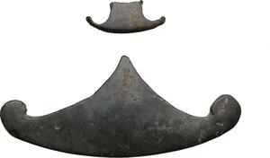 obverse: Varia romana.. Two bronze decorations, pelta shaped, 3rd century AD