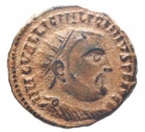 obverse: Impero Romano. Licinio I. 307-324 d.C. Follis Ridotto. D/ IMP C VAL LICIN LICINIVS PF AVG Busto radiato verso destra. R/ IOVI CONSERVATORI Giove stante verso sinistra regge globo con vittoriola ai suoi piedi un aquila tiene una corona nel becco X III SM ALB. Zecca di Alessandria. RIC.VII 28. Peso 3,70 gr. Diametro 18,88 mm. qSPL. Bellissima Patina Deserto.