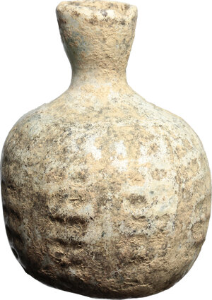 obverse: Late roman glass bottle, blown into a mould.  With white patina.  5th-6th century AD.  H. 6,5 cm