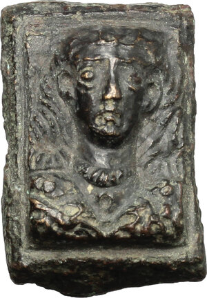 obverse: Bronze applique in the shape of female bust.  Roman period, 1st-3rd century AD.  27 x 18 mm