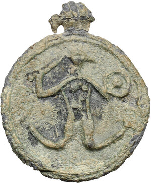obverse: Lead round pendant with Anguipede (Abraxas) with serpent legs, holding whip and shield.   Roman, 3rd-4th century AD.  21 mm