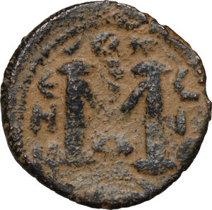 reverse: Umayyad Caliphate. Arab-Byzantine coinage (Pseudo-Byzantine type). . AE Fals, Emesa mint, c. 660-680