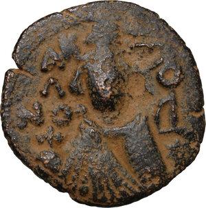 obverse: Umayyad Caliphate. Arab-Byzantine coinage (Pseudo-Byzantine type). . AE Fals, Emesa mint, 660-695