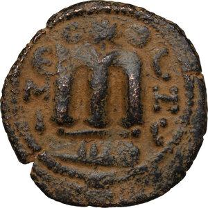 reverse: Umayyad Caliphate. Arab-Byzantine coinage (Pseudo-Byzantine type). . AE Fals, Emesa mint, 660-695