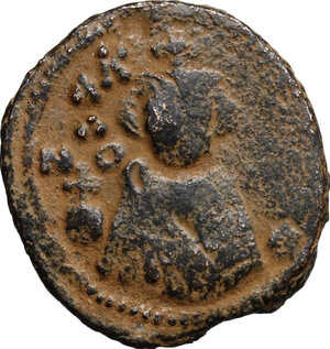 obverse: Arab-byzantine, Umayyad Caliphate, pre-reform coinage.. AE Fals, Emesa mint, 41-77 H / 661-697 AD