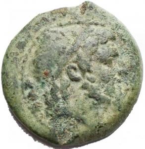 obverse: Varie. Paestum. After 180 BC. Æ Quadrans (4,26 gm). Head of Poseidon right; three pellets behind / Dolphin right; three pellets above. SNG ANS 740. VF Green patina.