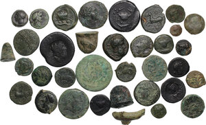 obverse: Greek Italy and Greek Sicily.. Lot of 35 unclassified AE denominations, including: Akragas, Syracuse, Panormos, Kainon, Gela, Himera, Pyrrhos, Metapontum and some countermarked pieces