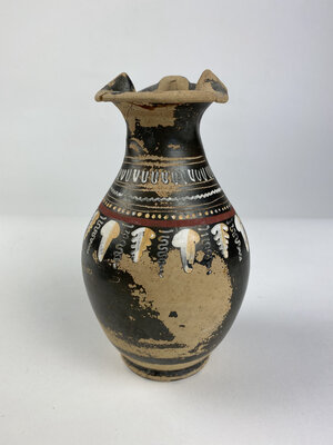 reverse: Greek Gnathia-Ware oinochoe.  The body decorated with geometric band and vine and ivy tendrils motif.  Apulia, 4th century BC.  H. 15 cm