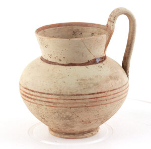 obverse: Daunian pottery olla.   Bulbous body, strap handle, flared rim and painted reddish-brown bands.  Dunia, 3th century BC.  H. 14 cm