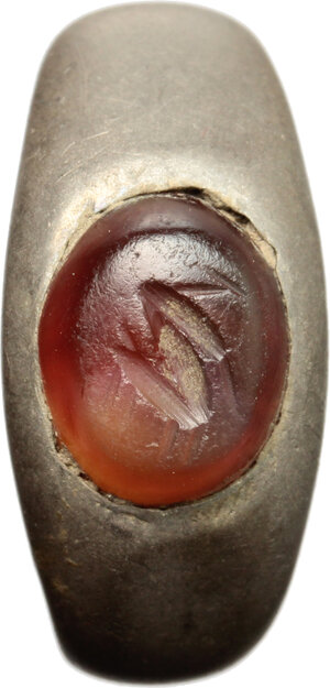 reverse: Silver ring with red carnelian gem engraved with stylized hare.  Roman period, 3nd-4rd century AD.   23 x 22 x 10 mm