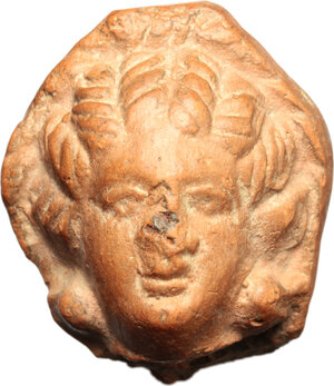 obverse: Hellenistic terracotta head of a woman.  Circa 3rd century BC.  H. 30 mm