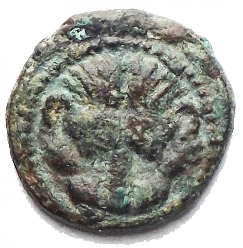 obverse: Mondo Greco -Bruttium. Rhegium.AE-onkia 420-410 a.C.D/ Testa di leone di fronte.R/ PH tra due foglie d olivo.HN(Italy) 2523.AE.g 0,61.mm 9,17. BB.Rara