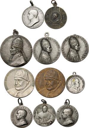 obverse: Medaglie Devozionali. Lotto di undici (11) medaglie di ambito religioso