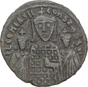 obverse: Basil I the Macedonian, with Constantine and Leo VI (867-886).. AE Follis. Constantinople mint, 870-879