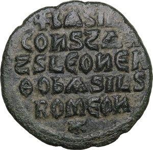 reverse: Basil I with Constantine and Leo VI (867-886).. AE Follis. Constantinople mint, 870-879