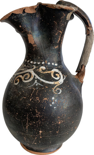 obverse: Gnathia-Ware Oinochoe.  The body decorated with ivy tendrils motif.  Apulia, 4th century BC.  Height 19 cm