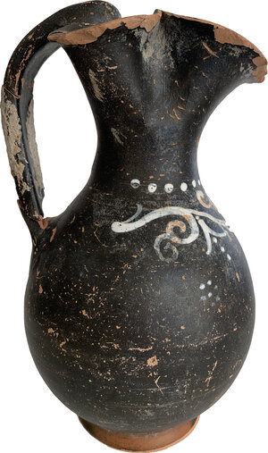 reverse: Gnathia-Ware Oinochoe.  The body decorated with ivy tendrils motif.  Apulia, 4th century BC.  Height 19 cm