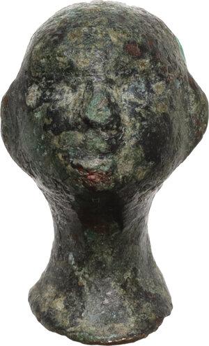 obverse: Bronze steelyard weight in the form of a wrestler s head.  Roman, 1st-3rd century AD.  18 mm. 8.45 g