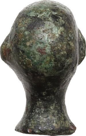 reverse: Bronze steelyard weight in the form of a wrestler s head.  Roman, 1st-3rd century AD.  18 mm. 8.45 g