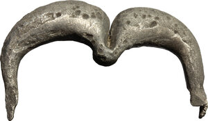 obverse: Silver brooch in the shape of a double arch.  Greek, 3rd  century BC  Pin missing.  40 mm. 15.40 g