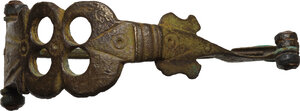 obverse: Bronze brooch with open work decorated bow.  Late roman / medieval period.  59 mm. 12.93 g