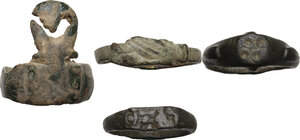 reverse: Lot of 4  bronze rings (including a key ring, and a clasped hands ring).  Roman period to middle ages