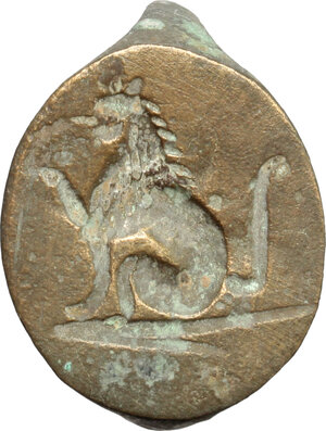 obverse: Bronze bezel of a ring with engraved seated lion.  Medieval period.  Bronze. 19 x 16 mm
