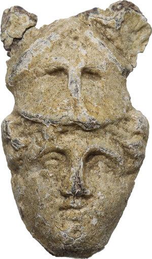 obverse: Lead Minerva with Corinthian Helmet applique.  Roman, 1st-3rd century AD.  40 x 24 mm. 44.75 g