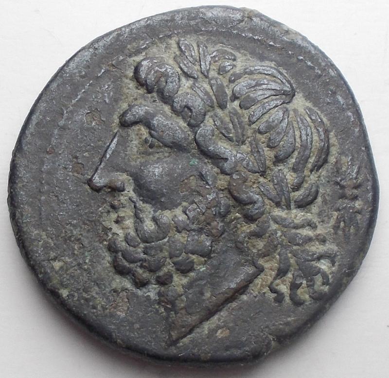 obverse: Mondo Greco - Apulia Arpi (III sec. a.C.) Obolo.D/ Testa di Zeus a sinistra.R/ Cinghiale a destra, sopra punta di freccia, sotto testina ? Gr 6,4. mm 21,58. AE. BB-qSPL/BB+