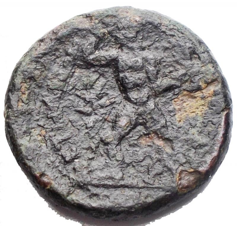 reverse: Mondo Greco - Bruttium Petelia. Bronzo. 214-204 a.C.D/ Testa velata di Demetra verso destra. R/ Zeus con scettro nell  atto di scagliare fulmini verso destra dietro una stella. Peso 7,46 g. Diametro 20,75 mm. qBB.R.