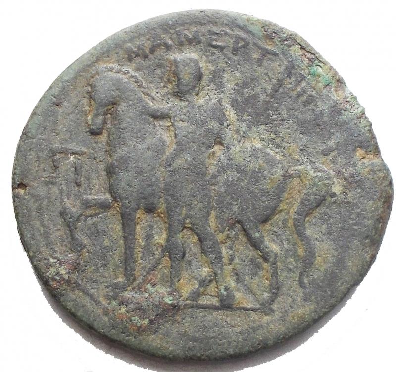 reverse: Mondo Greco -Sicilia.Messana, i Mamertini.Pentonkion, 230-200 a.C.D/ Testa di Ares a sinistra.R/ MAMEPTINN. Cavaliere stante di fronte, al fianco del proprio cavallo.Cfr. SNG ANS 429.gr. 9,45. mm 26,7.AE.qBB.