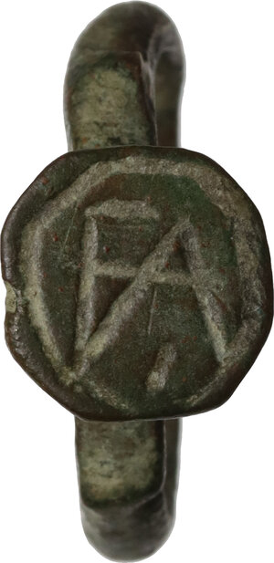 obverse: Bronze ring, bezel engraved with monogram.  Inner diameter 16mm  Byzantine Empire, 6th-10th century