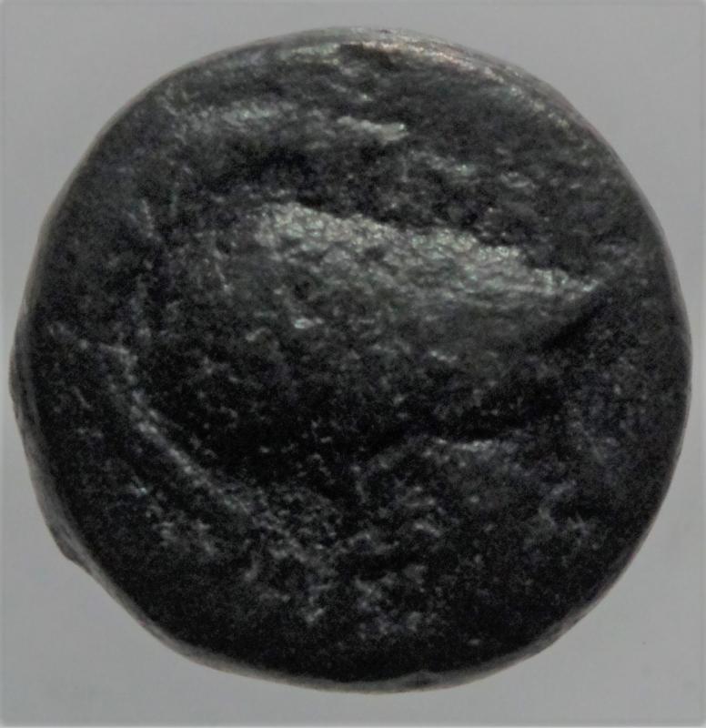 obverse: Mondo Greco.Tessalonica.II a.C.Ae.D\ Testa di Atena elmata a destra R\ Cavallo al passo verso destra.Peso 4,90 gr.Diametro 18 mm.BB