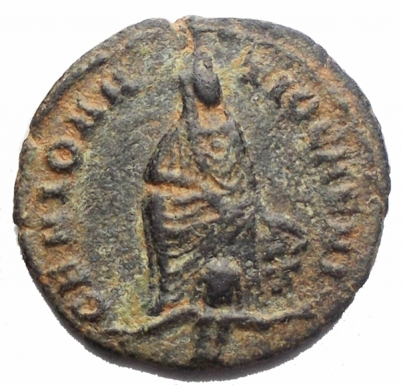 obverse: Impero Romano - Time of Maximinus II Æ16.  Persecution Issue . Antioch, AD 310-313. GENIO ANTIOCHENI, Tyche seated facing, river-god Orontes swimming below / APOLLONI SANCTO, Apollo standing left, holding patera and lyre; G in right field, SMA in exergue. 1.41g, 16.02mm Good Very Fine. Rare.  An active campaign of persecution against local Christians by Maximinus II reached its height during 310-313 the eastern cities in Nicomedia, Antioch, and Alexandria. Christians were subject to confiscation of land and property, and expelled from the cities; Churches were closed and ransacked. These three major mint cities struck a series of small bronzes honoring the old Greco-Roman gods - Jupiter, Apollo, Tyche, and Serapis among them. The persecutions subsided in AD 313 as a result of the Edict of Milan, jointly issued by Constantine and Licinius - the senior emperors - which proclaimed a policy of religious freedom, and returned confiscated property to the Christians.