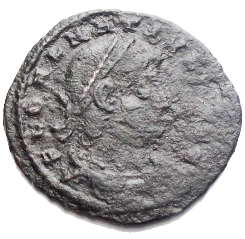 obverse: Impero Romano. Delmazio (335-337). Follis. R/ GLORIA EXERCITVS. Due soldati, stanti di fronte con lance e scudi, guardano uno stendardo situato tra di loro. gr 1,46. mm 18,4. qBB.§