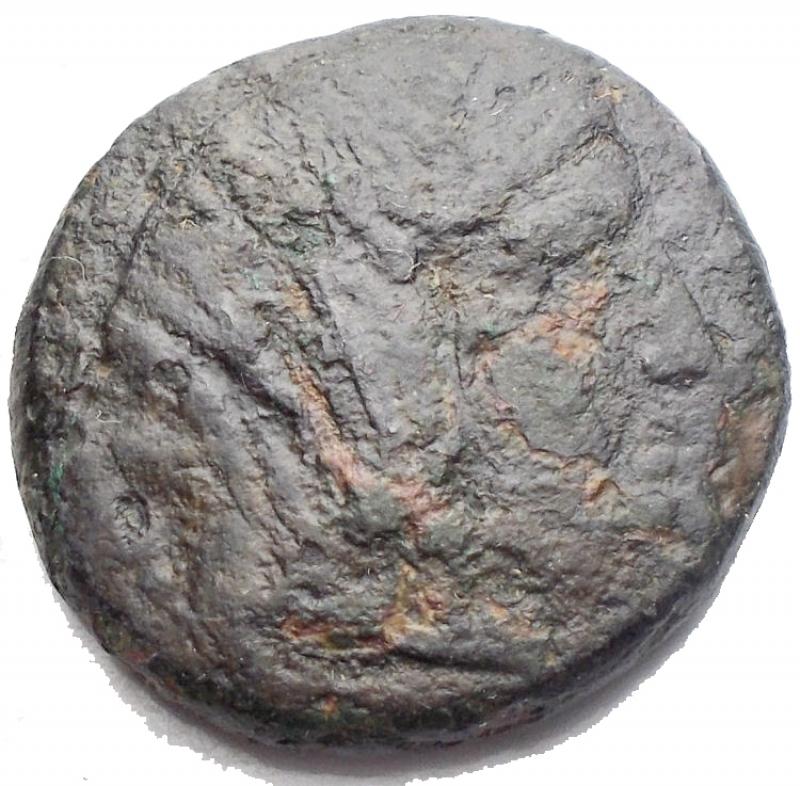 obverse: Mondo Greco - Bruttium Petelia. Bronzo. 214-204 a.C.D/ Testa velata di Demetra verso destra. R/ Zeus con scettro nell  atto di scagliare fulmini verso destra dietro una stella. Peso 7,46 g. Diametro 20,75 mm. qBB.R.