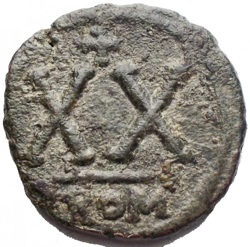 reverse: Bizantini -Tiberio II Costantino. 578-582 d.C.Ae. Mezzo Follis. Zecca Roma. Sear 467. Grammi 5,63. Millimetri 19,28 x 18,93.BB++.Raro