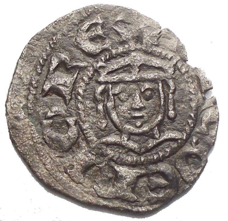 obverse: Zecche Italiane - Messina Enrico VI (1191-1197) Denaro del 1196a nome di Enrico e Federico. D/ Busto di Federico bambino. R/ Aquila. Gr. 0.59. MI. Sp.32. R. BB+. Argentatura