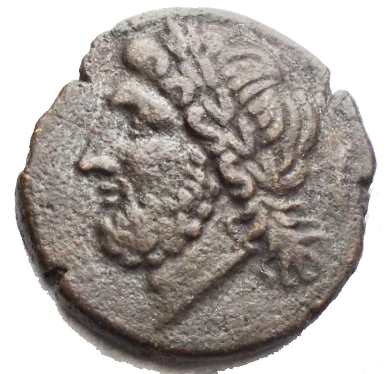 reverse: Mondo Greco - Apulia Arpi (III sec. a.C.) Obolo.D/ Testa di Zeus a sinistra.R/ Cinghiale a destra, sopra punta di freccia. g 6,75. mm 20,5. AE.SNG ANS 635.BB+/BB