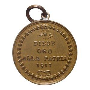 obverse: MEDAGLIA 1917 DIEDE ORO ALLA PATRIA 4 GR. 21 MM. SPL