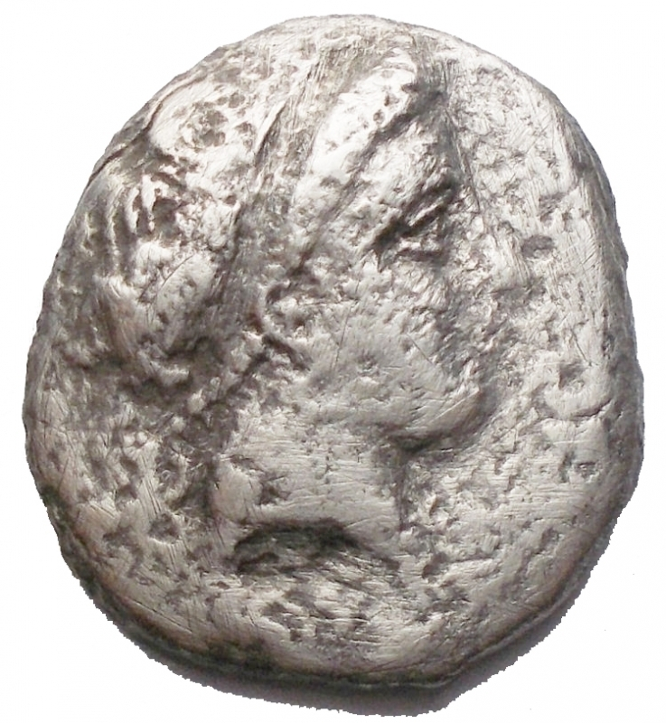 obverse: Mondo Greco - Campania Neapolis. 325-241 a.C. Nomos. AR. D/ Testa Diademata della Ninfa verso destra dietro simbolo R/ Toro androcefalo verso destra, sopra Nike in volo con corona. Peso 5,9 gr. MB+