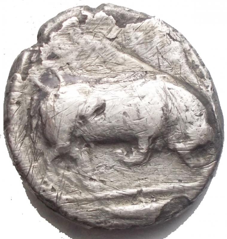 reverse: Mondo Greco - Lucania, Thurium. Nomos, 400-350. D/ Testa di Athena a destra, che indossa elmo attico decorato con Scilla. R/ Toro cozzante a destra. In esergo: pesce. AG. g 6,98. mm 18,7 x 19,9. qBB/MB+.