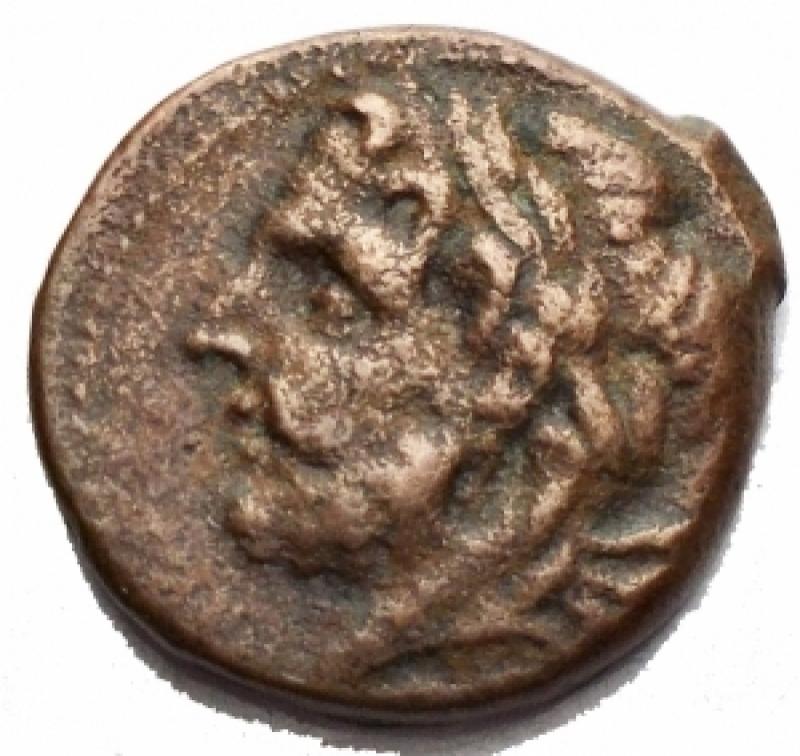 obverse: Mondo Greco - Apulia. Arpi. Obolo Ae. 217-213 a.C. d/Testa di Zeus verso sinistra. r/Cavallo al galoppo verso sinistra sopra una stella. Peso 3,6 g. Diametro 16,6 mm. BB
